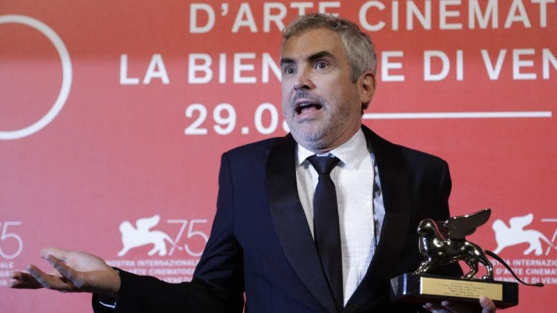 Director Alfonso Cuaron holds the Golden Lion Best Film award for 'Roma' at the awards photo call of the 75th edition of the Venice Film Festival in Venice, Italy, Saturday, Sept. 8, 2018. (AP Photo/Kirsty Wigglesworth)