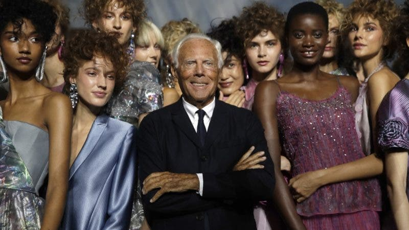 Designer Giorgio Armani, centre, poses with models at the end of his women's 2019 Spring-Summer collection, unveiled during the Fashion Week in Milan, Italy, Sunday, Sept. 23, 2018. (AP Photo/Luca Bruno)