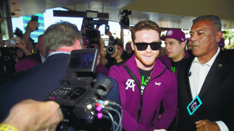 Middleweight boxer Canelo Alvarez of Mexico greets a fan as he arrives at the MGM Grand hotel-casino in Las Vegas Tuesday, Sept. 11, 2018. Alvarez will challenge WBC/WBA middleweight champion Gennady Golovkin of Kazakhstan in a rematch at T-Mobile Arena in Las Vegas on Sept. 15. (Steve Marcus/Las Vegas Sun via AP)