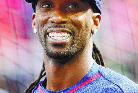National League outfielder Andrew McCutchen, of the Pittsburgh Pirates, waits to hit during batting practice before the MLB All-Star baseball game, Tuesday, July 15, 2014, in Minneapolis. (AP Photo/Paul Sancya)