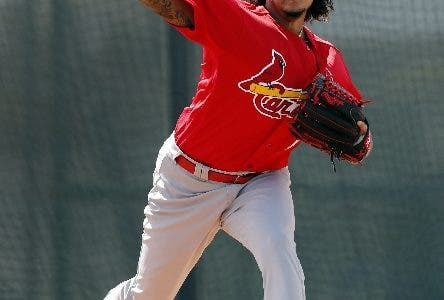St. Louis Cardinals pitcher Carlos Martinez throws a bullpen session during spring training baseball practice Wednesday, Feb. 14, 2018, in Jupiter, Fla. (AP Photo/Jeff Roberson)