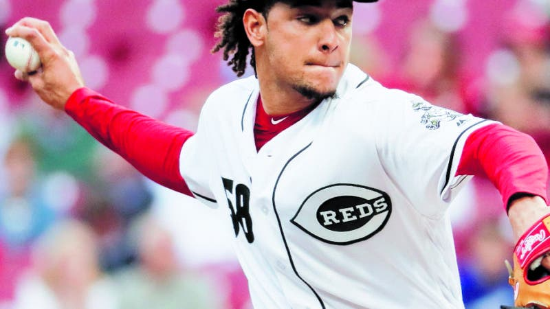 Cincinnati Reds starting pitcher Luis Castillo throws in the first inning of a baseball game against the Los Angeles Dodgers, Tuesday, Sept. 11, 2018, in Cincinnati. (AP Photo/John Minchillo)