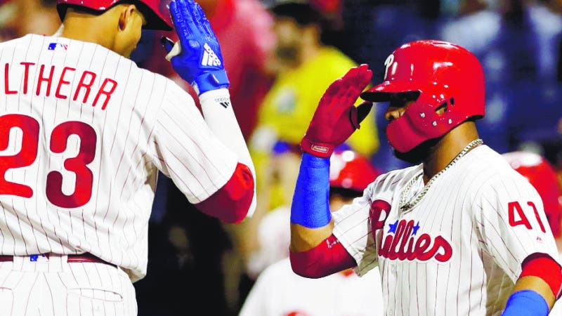 Philadelphia Phillies' Aaron Altherr, left, and Carlos Santana celebrate after Altherr's two-run home off Miami Marlins starting pitcher Wei-Yin Chen during the second inning of a baseball game, Friday, Sept. 14, 2018, in Philadelphia. (AP Photo/Matt Slocum)