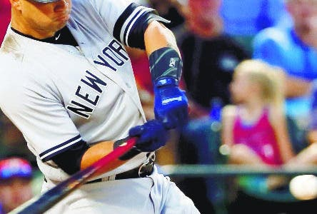 New York Yankees' Gary Sanchez hits a two-run single off Texas Rangers' Martin Perez during the second inning of a baseball game, Friday, Sept. 8, 2017, in Arlington, Texas. (AP Photo/Tony Gutierrez)