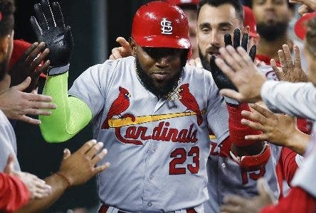 St. Louis Cardinals' Marcell Ozuna (23) celebrates his solo home run in the fourth inning of a baseball game against the Detroit Tigers in Detroit, Friday, Sept. 7, 2018. (AP Photo/Paul Sancya)