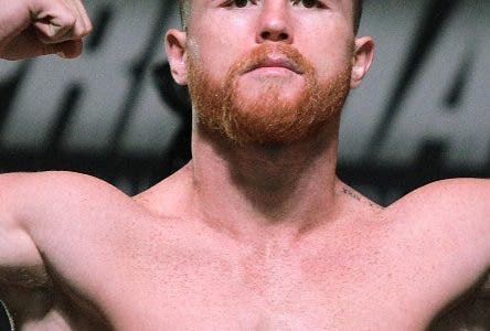 """(FILES) In this file photo taken on September 15, 2017 boxer Canelo Alvarez poses on the scales during a weigh-in with Gennady Golovkin at the MGM Grand Hotel & Casino in Las Vegas, Nevada.  Mexican middleweight Saul """"Canelo"""" Alvarez was handed a six-month ban by the Nevada State Athletic Commission on April 18, 2018 over the failed drug test which forced his rematch with Gennady Golovkin to be cancelled. At a hearing in Las Vegas, the commission unanimously approved a deal that will see Alvarez suspended for six months from the date of his failed test on February 17. / AFP / John GURZINSKI"""
