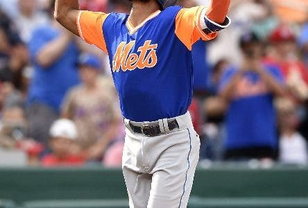 New York Mets' Amed Rosario celebrates his home run during the eighth inning of the first baseball game of a split doubleheader against the Washington Nationals, Sunday, Aug. 27, 2017, in Washington. (AP Photo/Nick Wass)