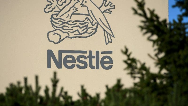 (FILES) This file photo taken on October 09, 2014 shows a logo of the world's leading food industry group Nestle at the group's Research Center in Vers-chez-les-Blanc above Lausanne.   Swiss food giant Nestle on February 15, 2018 appeared to open the door to selling its stake in French cosmetics group L'Oreal after it said that its own business performance in 2017 fell short of expectations.  / AFP / Fabrice COFFRINI