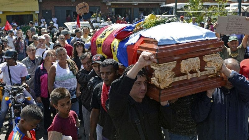 "Relatives, friends and pro-government supporters carry the coffin of Juan Montoya, known as ""Juancho"" who was one of the three killed during the recent protest in Caracas, on February 13, 2014. Venezuela's government on Thursday called for its supporters to rally against what it called fascism, a day after three people died and dozens were injured in violence at anti-government protests. Thousands demonstrated on Wednesday against rampant crime, inflation and shortages of basic goods in the biggest challenge to President Nicolas Maduro since he took over from the late Hugo Chavez last year. The protests ended with three people shot to death -- a pro-government demonstrator and two student opposition protesters. AFP PHOTO/LEO RAMIREZ"