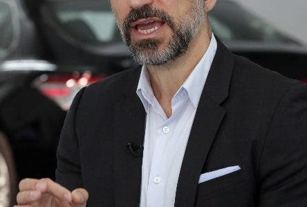 Uber CEO Dara Khosrowshahi speaks during an interview after the company unveiled new features in New York, Wednesday, Sept. 5, 2018. Uber is aiming to boost driver and passenger safety in an effort to rebuild trust in the brand. (AP Photo/Richard Drew)