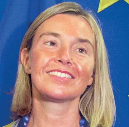 European Union foreign policy chief Federica Mogherini, right, shakes hands with Colombia's Foreign Minister Carlos Holmes Trujillo Garcia at EU headquarters in Brussels, Tuesday, Sept. 18, 2018. (AP Photo/Virginia Mayo, Pool)