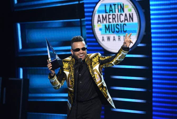 """1. Nacho accepts the award for favorite tropical song for """"Bailame"""" at the Latin American Music Awards at the Dolby Theatre on Thursday, Oct. 25, 2018, in Los Angeles. (Photo by Chris Pizzello/Invision/AP)"""