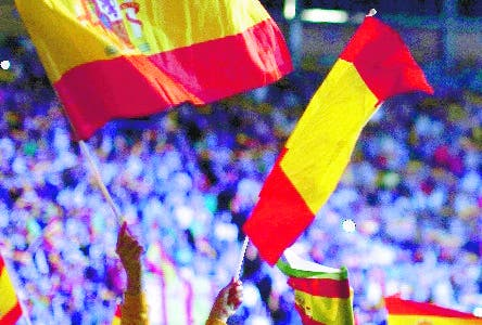 A girl waves a Spanish flag during a rally of the fledging far-right party VOX in Madrid, Spain, Sunday, Oct. 7, 2018. Thousands of Spaniards have attended a rally of the fledging far-right party VOX as it tries to grab a foothold in Spain's political spectrum. (AP Photo/Manu Fernandez)