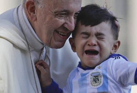 Pope Francis caresses a child as he arrives with the popemobile in St.Peter's Square on the occasion of his weekly general audience at the Vatican, Wednesday, Oct. 10, 2018. (AP Photo/Gregorio Borgia)
