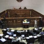 Lawmakers debate a proposed law that would give Venezuela's President Hugo Chavez the power to rule by decree for one year at the National Assembly in Caracas, Venezuela, Friday Dec. 17, 2010.  A new congress goes into session Jan. 5 with an opposition contingent large enough to hinder approval of some types of major legislation. (AP Photo/Fernando Llano)