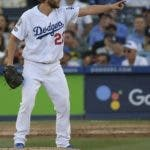 Los Angeles Dodgers's Clayton Kershaw gestures after an out during the seventh inning of Game 5 of the National League Championship Series baseball game against the Milwaukee Brewers Wednesday, Oct. 17, 2018, in Los Angeles. (AP Photo/Mark J. Terrill)
