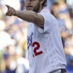 Los Angeles Dodgers's Clayton Kershaw gestures after an out during the seventh inning of Game 5 of the National League Championship Series baseball game against the Milwaukee Brewers Wednesday, Oct. 17, 2018, in Los Angeles. (AP Photo/Jae Hong)
