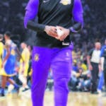 Los Angeles Lakers' LeBron James walks back to the bench after a timeout during the first half of the team's preseason NBA basketball game against the Golden State Warriors on Friday, Oct. 12, 2018, in San Jose, Calif. (AP Photo/Ben Margot)