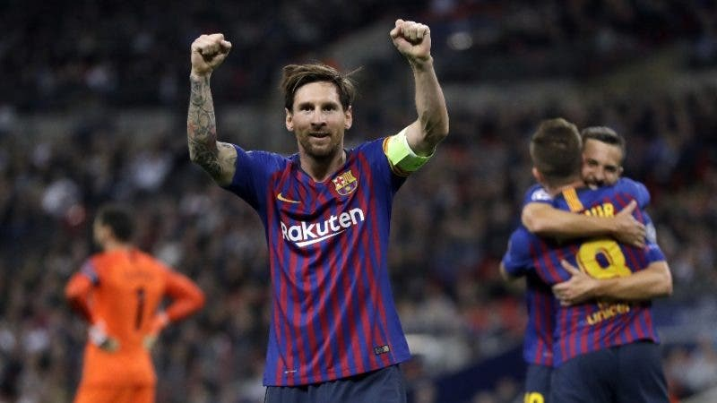 Barcelona forward Lionel Messi, center, celebrates after scoring his side's third goal during the Champions League Group B soccer match between Tottenham Hotspur and Barcelona at Wembley Stadium in London, Wednesday, Oct. 3, 2018. (AP Photo/Kirsty Wigglesworth)