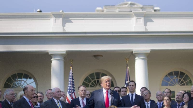 President Donald Trump, center, speaks as he announces a revamped North American free trade deal, in the Rose Garden of the White House in Washington, Monday, Oct. 1, 2018. The new deal, reached just before a midnight deadline imposed by the U.S., will be called the United States-Mexico-Canada Agreement, or USMCA. It replaces the 24-year-old North American Free Trade Agreement, which President Donald Trump had called a job-killing disaster. (AP Photo/Pablo Martinez Monsivais)