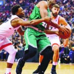 Toronto Raptors guard Kyle Lowry (7) defends as Boston Celtics forward Al Horford (42) as he drives to the basket during the first half of an NBA basketball game, Friday, Oct. 19, 2018 in Toronto. (Frank Gunn/The Canadian Press via AP)