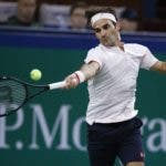 Roger Federer of Switzerland hits a return shot to Daniil Medvedev of Russia during their men's singles match of the Shanghai Masters tennis tournament at Qizhong Forest Sports City Tennis Center in Shanghai, China, Wednesday, Oct. 10, 2018. (AP Photo/Andy Wong)