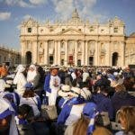 Faithful gather prior to a canonization ceremony in St. Peter's Square at the Vatican, Sunday, Oct. 14, 2018. Pope Francis canonizes two of the most important and contested figures of the 20th-century Catholic Church, declaring Pope Paul VI and the martyred Salvadoran Archbishop Oscar Romero as models of saintliness for the faithful today. (AP Photo/Andrew Medichini)