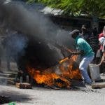 Demonstrators setup a barricade during a protest demanding to know how Petro Caribe funds have been used by the current and past administrations, in Port-au-Prince, Haiti, Wednesday, Oct. 17, 2018. Much of the financial support to help Haiti rebuild after the 2010 earthquake comes from Venezuela's Petro Caribe fund, a 2005 pact that gives suppliers below-market financing for oil and is under the control of the central government. (AP Photo/Dieu Nalio Chery)