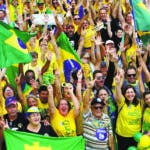 Supporters of presidential candidate Jair Bolsonaro, of the right-wing Social Liberal Party, rally in Brasilia, Brazil, Sunday, Oct. 21, 2018, one week before Brazilians return to the polls on Oct. 28 for the second round of voting. (AP Photo/Eraldo Peres)