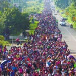 Central American migrants walking to the U.S. start their day departing Ciudad Hidalgo, Mexico, Sunday, Oct. 21, 2018. Despite Mexican efforts to stop them at the border, about 5,000 Central American migrants resumed their advance toward the U.S. border early Sunday in southern Mexico. (AP Photo/Moises Castillo)