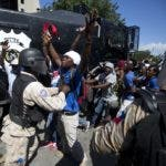 Demonstrators clash with police during a protest demanding to know how Petro Caribe funds have been used by the current and past administrations, in Port-au-Prince, Haiti, Wednesday, Oct. 17, 2018. Much of the financial support to help Haiti rebuild after the 2010 earthquake comes from Venezuela's Petro Caribe fund, a 2005 pact that gives suppliers below-market financing for oil and is under the control of the central government. (AP Photo/Dieu Nalio Chery)