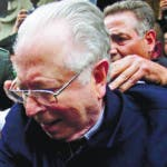 """FILE - In this Nov. 11, 2015 file photo, Fernando Karadima is escorted from a court, after testifying in a case that three of his victims brought against the country's Catholic Church in Santiago, Chile. Pope Francis has on Friday, Sept. 29, 2018, defrocked Karadima, a priest at the center of the global sex abuse scandal rocking his papacy, invoking his """"supreme"""" authority to stiffen a sentence originally handed down by a Vatican court in 2011. (AP Photo/Luis Hidalgo, File)"""