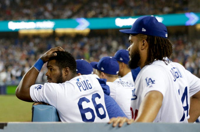 6. Los Angeles Dodgers right fielder Yasiel Puig watches during the ninth inning in Game 5 of the World Series baseball game against the Boston Red Sox on Sunday, Oct. 28, 2018, in Los Angeles. (AP Photo/Jae C. Hong)