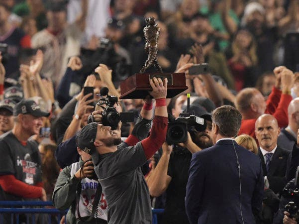 8. Boston Red Sox's Steve Pearce holds the MVP trophy after Game 5 of baseball's World Series against the Los Angeles Dodgers on Sunday, Oct. 28, 2018, in Los Angeles. The Red Sox won 5-1 to win the series 4 game to 1. (AP Photo/Mark J. Terrill)