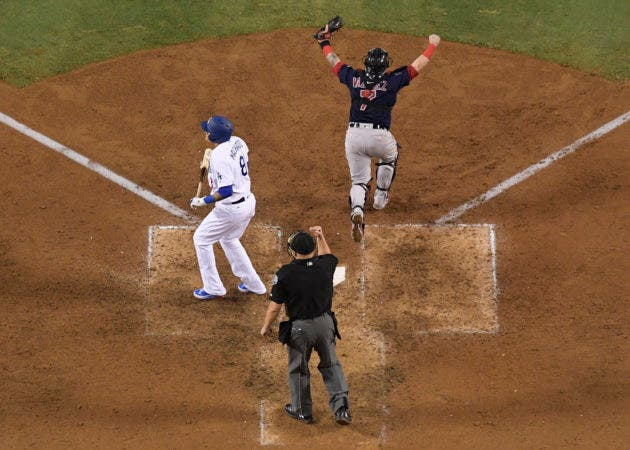 9. Home plate umpire Jeff Nelson makes the call while Boston Red Sox catcher Christian Vazquez celebrates as Los Angeles Dodgers' Manny Machado strikes out to end Game 5 of baseball's World Series against the Los Angeles Dodgers on Sunday, Oct. 28, 2018, in Los Angeles. The Red Sox won 5-1 to win the series 4 game to 1. (AP Photo/Mark J. Terrill)