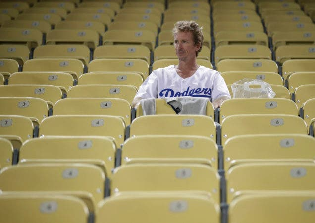 11. A Los Angeles Dodgers fan sits in the stands after Game 5 of baseball's World Series against the Los Angeles Dodgers on Sunday, Oct. 28, 2018, in Los Angeles. The Red Sox won 5-1 to win the series 4 game to 1. (AP Photo/Jae C. Hong)
