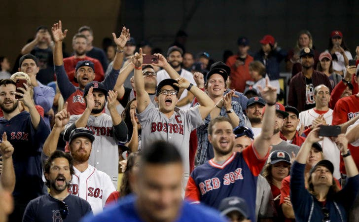 13. Fans celebrates after the Boston Red Sox won Game 5 of baseball's World Series against the Los Angeles Dodgers on Sunday, Oct. 28, 2018, in Los Angeles. The Red Sox won 5-1 to win the series 4 games to 1. (AP Photo/Elise Amendola)