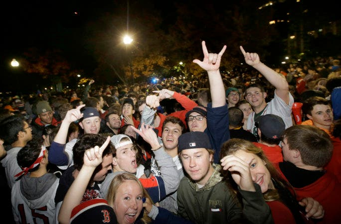 15. Boston Red Sox fans celebrate the team's victory in the World Series on the Boston Common, in Boston, early Monday, Oct. 29, 2018, after Red Sox beat the Los Angeles Dodgers 5-1, in Los Angeles on Sunday to win the series 4 games to 1. (AP Photo/Steven Senne)