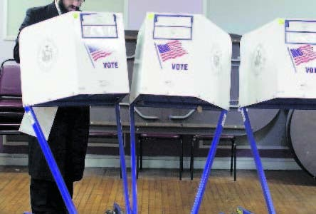 Members of the orthodox jewish community fill out ballot papers at a polling center on Tuesday, Nov. 6, 2018, in Brooklyn borough of New York. (AP Photo/Wong Maye-E)