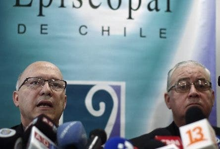 """Catholic Priests Fernando Ramos, left, and Juan Ignacio Gonzalez, spokespersons for the Episcopal Conference, speak to the press about a letter from Pope Francis in Santiago, Chile, Thursday, May 31, 2018. Pope Francis became the first pope to publicly denounce a """"culture of abuse and cover-up"""" in the Catholic Church, saying Thursday in a pastoral letter to the Chilean faithful, that he was ashamed that neither he nor Chile's Catholic leaders truly ever listened to victims as the country's abuse scandal spiraled. (AP Photo/Luis Hidalgo)"""