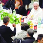 Pope Francis sits at a lunch, at the Vatican, Sunday, Nov. 18, 2018. Pope Francis is offering several hundred poor people, homeless, migrants, unemployed a lunch on Sunday as he celebrates the World Day of the Poor with a concrete gesture of charity in the spirit of his namesake, St. Francis of Assisi. (AP Photo/Andrew Medichini)
