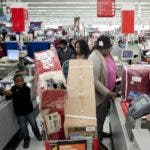 BRAINTREE, MA - NOVEMBER 23: Shoppers wait in a check out line at Kmart during the Black Friday sales on November 23, 2012 in Braintree, Massachusetts. Black Friday, the start of the holiday shopping season, has traditionally been the busiest shopping day in the United States.   Allison Joyce/Getty Images/AFP== FOR NEWSPAPERS, INTERNET, TELCOS & TELEVISION USE ONLY ==