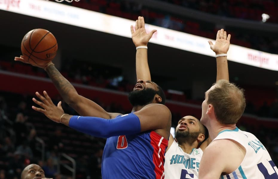 Detroit Pistons center Andre Drummond (0) shoots as Charlotte Hornets forward Nicolas Batum (5) defends during the second half of an NBA basketball game, Sunday, Nov. 11, 2018, in Detroit. (AP Photo/Carlos Osorio)
