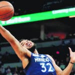 Minnesota Timberwolves' Karl-Anthony Towns (32) rebounds against the Memphis Grizzlies during the second quarter of an NBA basketball game on Sunday, Nov. 18, 2018, in Minneapolis. (AP Photo/Hannah Foslien)