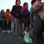 Central American migrants, as part of the Central American caravan trying to reach the United States, wait to receive donated dinner downtown in Mexicali, Mexico, Monday, Nov. 19, 2018. The United States closed off northbound traffic for several hours at the busiest border crossing with Mexico to install new security barriers on Monday, a day after hundreds of Tijuana residents protested against the presence of thousands of Central American migrants.(AP Photo/Rodrigo Abd)