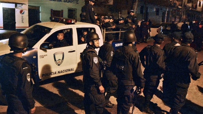 """Police officers patrol the poor community of Las Ayestas, in Tegucigalpa on February 5, 2013. Honduras' notorious street gangs, especially the Mara 18 and the Mara 13 or Salvatrucha, have imposed a curfew and are charging a """"war tax"""" in some of the capital's poorest sectors -- thing which led the police to deploy more personnel in theses areas. The violent maras are active in murders, extorsion, drug dealing, arms trafficking and other crimes. The United Nations says Honduras, a country plagued by powerful street gangs and drug-related violence, has the world's highest homicide rate. In 2010 it was 82 per 100,000 inhabitants, and rose to 86 in 2011. By comparison, in drug-cartel-plagued Mexico, for instance, the rate was about 18 in 2010.  AFP PHOTO/Orlando SIERRA"""