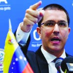 FILE - In this June 6, 2018 file photo, Venezuela's Foreign Minister Jorge Arreaza gives a news conference at the Organization of American States (OAS) in Washington. Arreaza said Monday, Sept. 24, 2018 that he is ready to crash a meeting at the U.N. called to help surrounding countries struggling to deal with the flood of migrants fleeing his nation's economic crisis. (AP Photo/Jose Luis Magana, File)