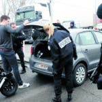 French police officers control cars at the French-German border following a shooting in Strasbourg, eastern France, Wednesday, Dec. 12, 2018. A man who had been flagged as a possible extremist sprayed gunfire near the city of Strasbourg's famous Christmas market Tuesday, killing three people, wounding 12 and sparking a massive manhunt. France immediately raised its terror alert level. (AP Photo/Christophe Ena)