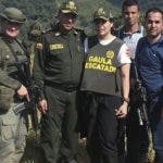 In this handout photo released by the press office of Colombia's National Police, Melissa Martinez Garcia poses for a photo with the officers that rescued her, in a rural area of Ciengaga, northern Colombia, Monday, Dec. 17, 2018. Martinez Garcia, grand niece of the late Literature Nobel Price winner Gabriel Garcia Marquez, was kidnapped on Aug. 23, 2018 when she was returning to her home in Santa Marta, from her job on a banana plantation. (Colombia's National Police Press Office via AP)