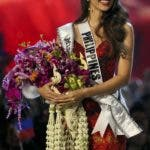 Miss Philippines Catriona Gray walks after being crowned Miss Universe during the final round of 67th Miss Universe competition in Bangkok, Thailand, Monday, Dec. 17, 2018. (AP Photo/Gemunu Amarasinghe)